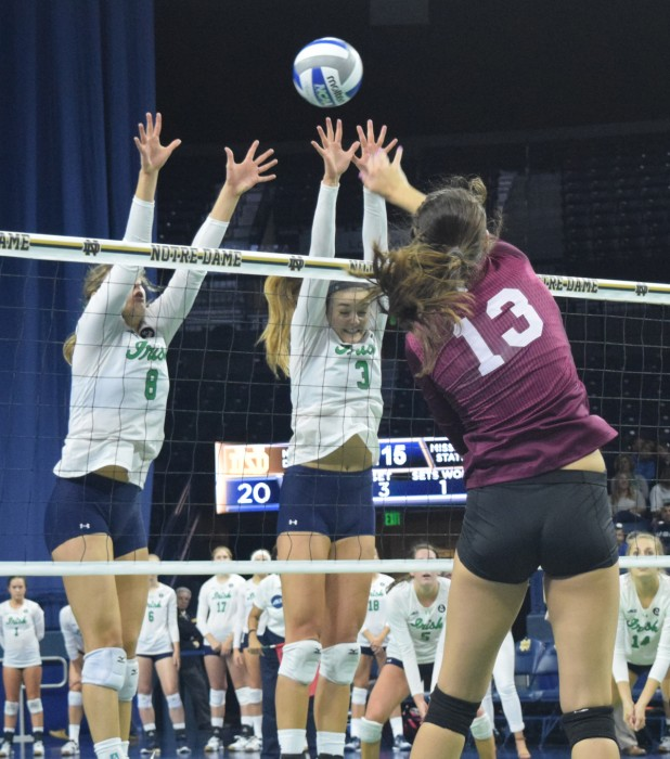 Sophomore outside hitter Sam Fry (right) and sophomore setter Maddie Dilfer go up for a block during  a 3-1 victory against Mississippi State on Sept. 11 at Purcell Pavilion.