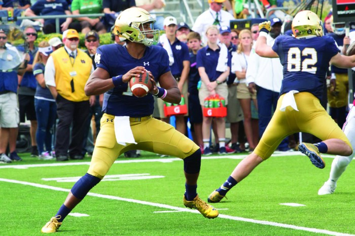 Irish sophomore quarterback DeShone Kizer fires a pass downfield during Notre Dame's 62-27 home       victory over Massachusetts on Saturday.