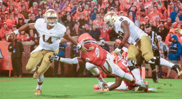 Sophomore quarterback DeShone Kizer breaks a tackle during Notre Dame's loss to No. 6 Clemson on Saturday at Memorial Stadium. The Irish coaching staff has praised his poise and leadership despite the loss. Notre Dame will look to rebound this Saturday when it welcomes Navy to campus.