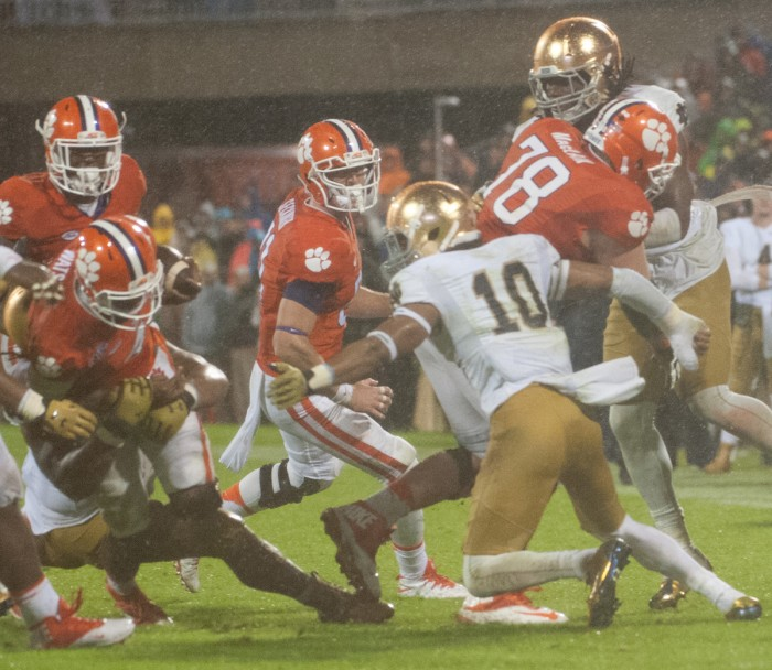 Irish junior safety Max Redfield attempts to make a tackle during Notre Dame's 24-22 loss against Clemson on Saturday at Memorial Stadium. Redfield led the Irish with 14 tackles in the game.