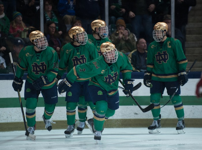 The Notre Dame hockey team celebrates after a goal against Boston College on Feb. 28. The Irish beat Guelph in an exhibition of the season on Friday at Compton Family Ice Arena.