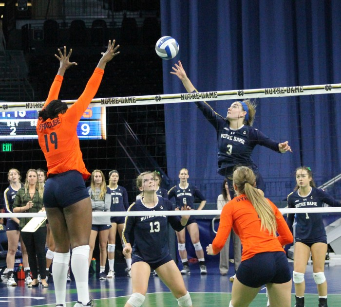 Sophomore outside hitter Sam Fry jumps to tip during Notre Dame's loss to Syracuse on Oct. 4. Fry had 13 kills against Clemson on Friday.