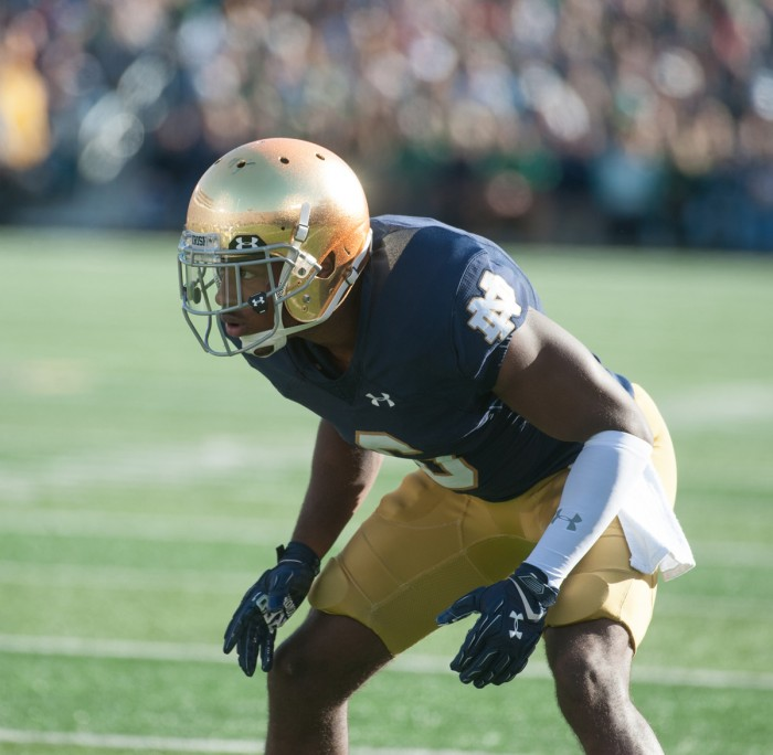 Notre Dame senior cornerback KeiVarae Russell lines up before a play as the rest those at Notre Dame Stadium is reflected off his helmet during the game Saturday.
