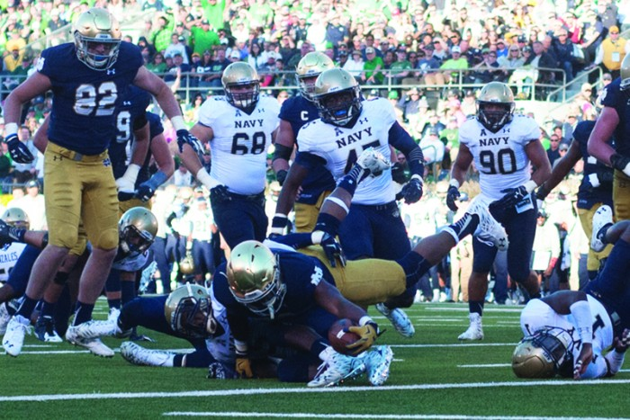 Irish senior running back C.J. Prosise stretches across the goal line for one of his three touchdowns  Saturday during Notre Dame's 41-24 victory over Navy at Notre Dame Stadium.