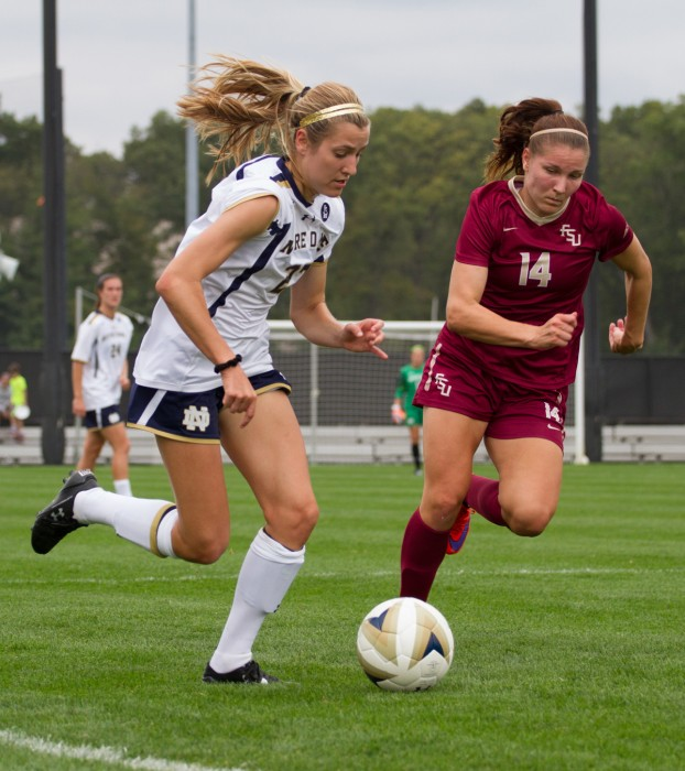 Irish sophomore defender Ginny McGowan dribbles around a defender during a 1-0 loss to Florida State on Sept. 27 at Alumni Stadium. McGowan has started in eight games this season.