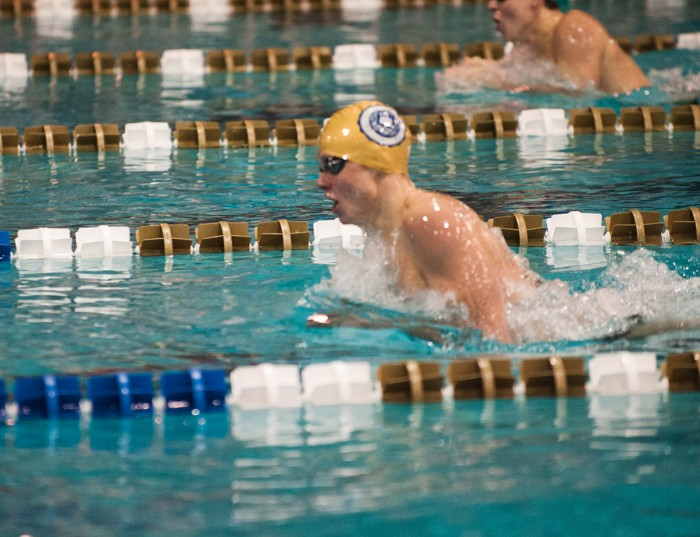 Junior Reed Fujan swims the 200-yard individual medley during Notre Dame's 226-66 victory over Cleveland State on Feb. 7.