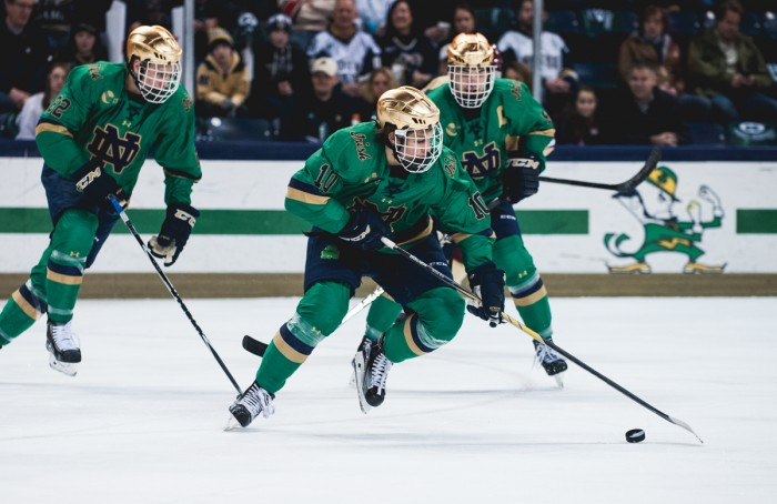 Sophomore left winger Anders Bjork controls the puck during Notre Dame's 3-1 win over Boston College on Feb. 28.