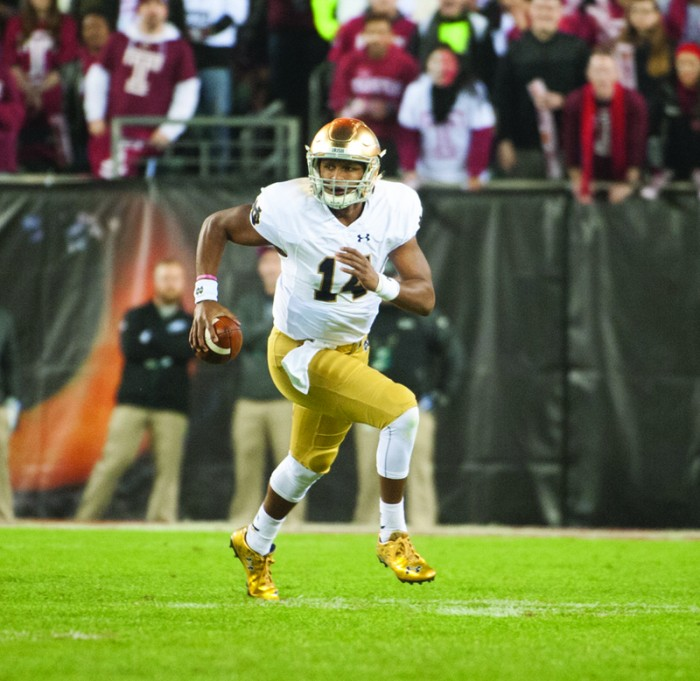Sophomore quarterback DeShone Kizer scrambles down the field during Notre Dame's 24-20 win against Temple on Saturday.