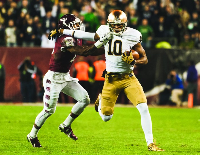 Irish freshman tight end Alizé Jones tries to push off a Temple defender on a 45-yard reception in Notre Dame's 24-20 victory over the Owls last Saturday at Lincoln Financial Field in Philadelphia.