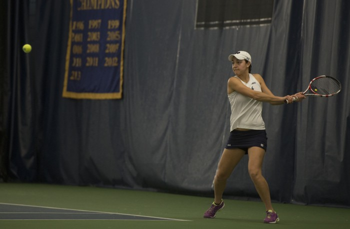Senior Quinn Gleason prepares to hit a backhand during Notre Dame's 6-1 loss to Stanford on Feb. 6 at Eck Family Tennis Pavilion. Gleason won all three of her signles matches this weekend.