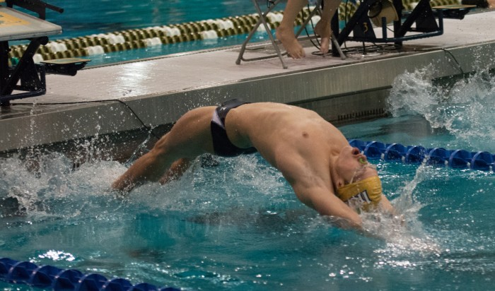 Junior Kevin Bradley dives into the pool at the start of a race during Notre Dame's 161-139 loss to Purdue on Nov. 1, 2014.