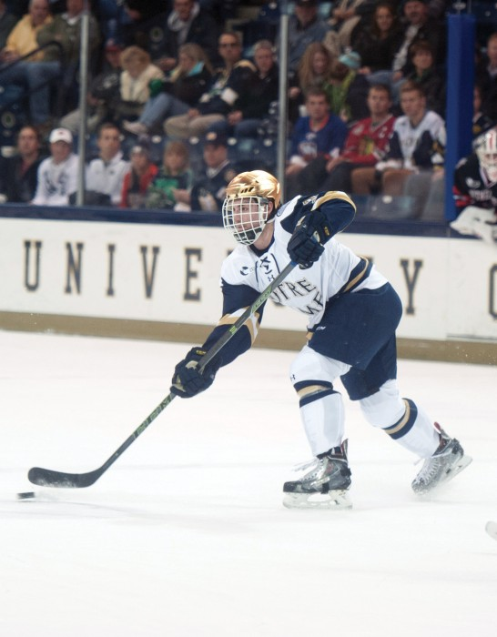 Sophomore defenseman Jordan Gross passes the puck during Notre Dame's 3-2 win over Northeastern on Thursday.
