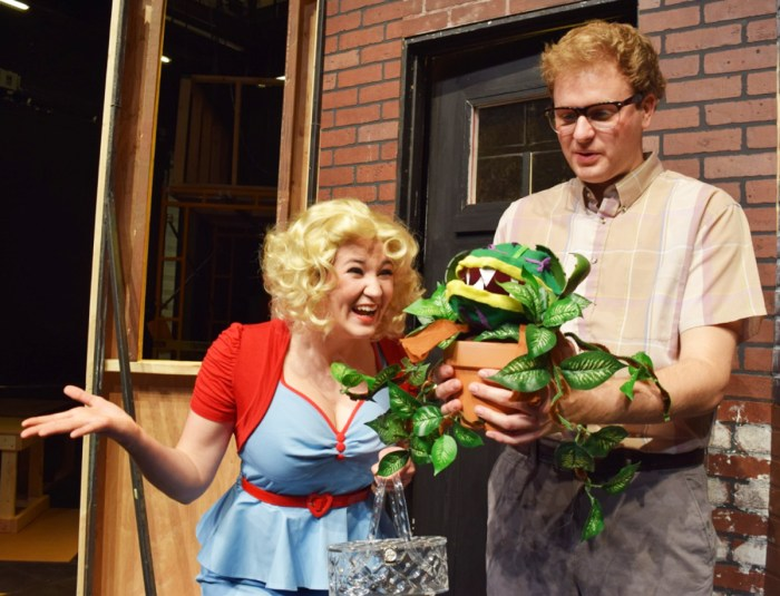 "Juniors Maggie Moran (left) and Quint Mediate prepare for their upcoming performance of ""The Little Shop of Horrors."""
