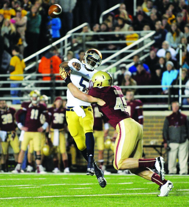 Former Irish quarterback Everett Golson is hit by a Boston College defender as he throws during Notre Dame's 21-6 win at Alumni Stadium in Boston on Nov. 10, 2012.