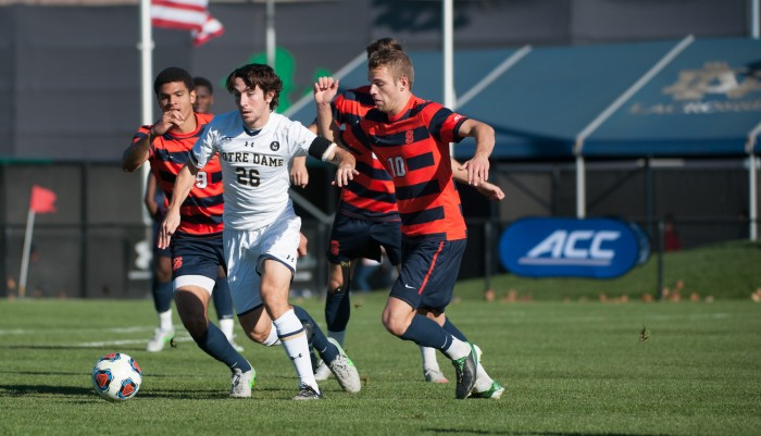 Junior midfielder Mark Gormley fend off defenders during Notre Dame's 1-0 loss to Syracuse on Sunday in the ACC championship game at Alumni Stadium. Notre Dame starts NCAA tournament play this Sunday against Tulsa.