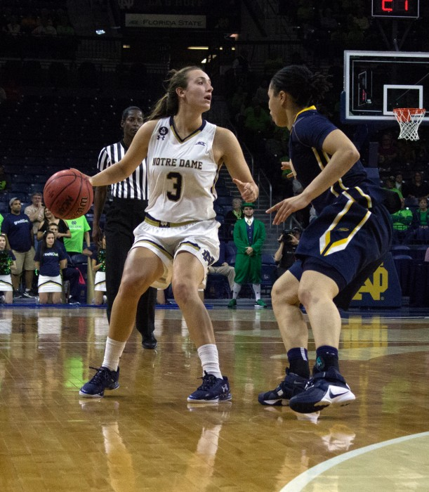 Irish freshman guard Marina Mabrey looks for a passing lane during Notre Dame's 74-39 win over Toledo on Nov. 18 at Purcell Pavilion.