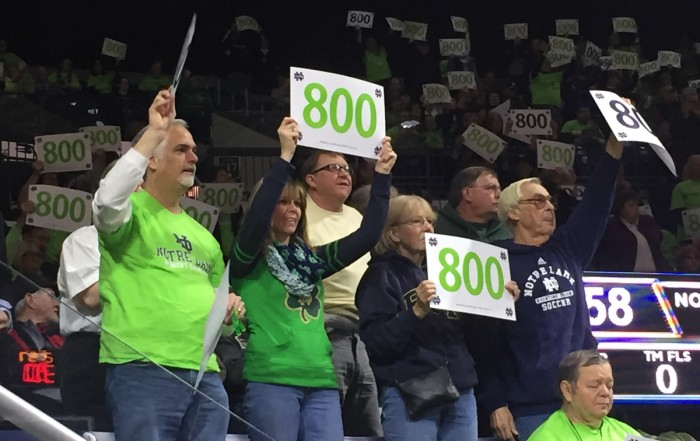 "Fans hold up signs with the number ""800"" written on them Saturday at Purcell Pavilion to honor Irish head coach Muffet McGraw's 800th career victory."