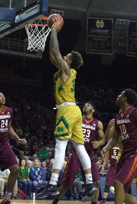 Senior forward Zach Auguste throws home a dunk during a 83-81 victory over Virginia Tech on Wednesday at Purcell Pavilion.