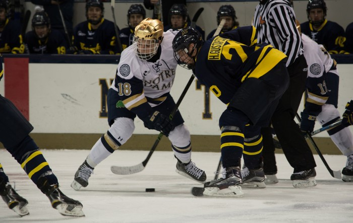 Irish sophomore center Jake Evans fights for a faceoff win during Notre Dame's 7-2 win over Merrimack on Jan. 15 at Compton Family Ice Arena. Evans has registered a point in six straight games for the Irish.