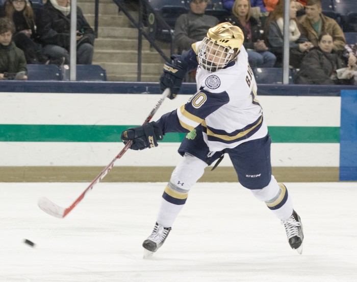 Irish sophomore left wing Anders Bjork snaps a shot on goal during Notre Dame's 5-1 win over Massachusetts on Dec. 5.