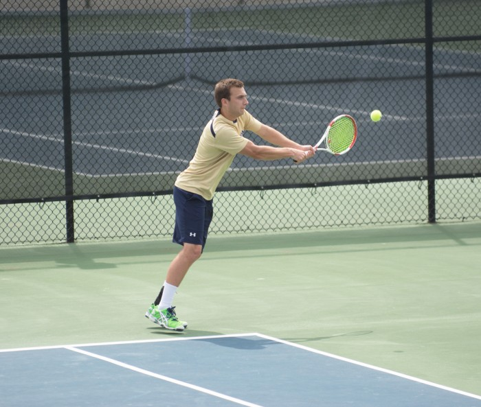 Junior Eddy Covalschi returns a shot during Notre Dame's victory over Clemson on April 10 at Courtney Tennis Center. Covalschi lost his doubles match with junior Josh Hagar in Friday's Irish loss.