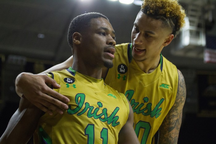 Irish junior guard Demetrius Jackson, left, and senior forward Zach Auguste talk following a play in Notre Dame's 80-76 win over No. 2 North Carolina on Saturday night at Purcell Pavilion.