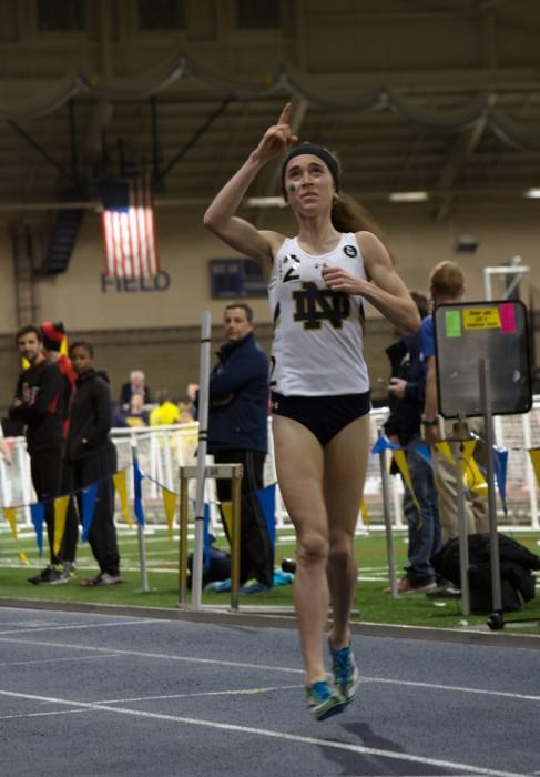Irish senior Molly Seidel crosses the finish line of the 3,000-meter run after setting a new school record on Saturday at Loftus Sports Center.