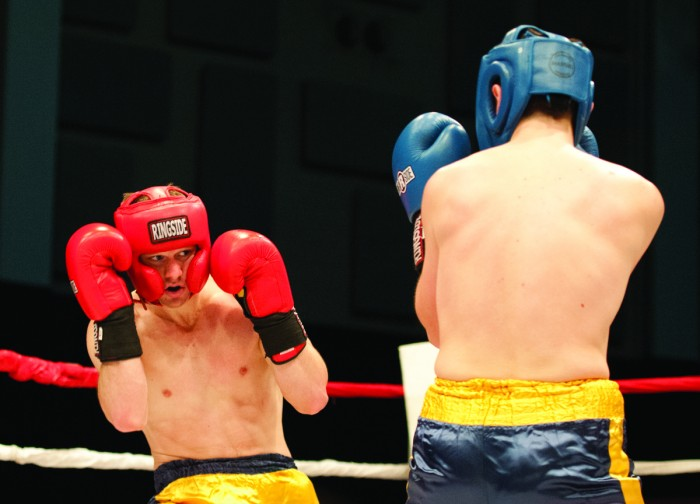 """Senior Matthew """"Yeoman"""" Schaefer, left, sizes up sophomore Jeff Graziano during Bengal Bouts action Sunday at the JACC. Schaefer defeated Graziano by unanimous decision in the 157 pound weight class."""