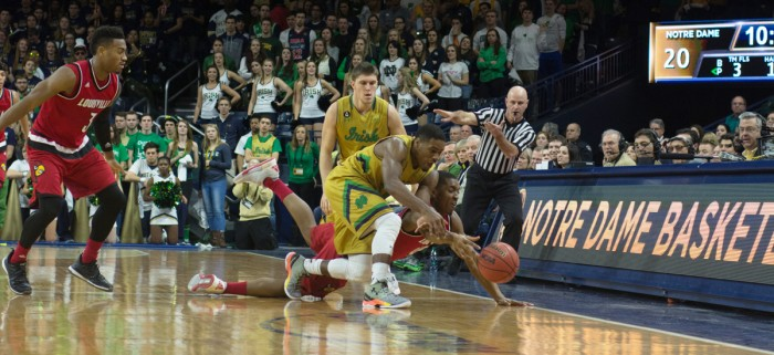 Irish junior guard Demetrius Jackson dives for a ball during Notre Dame's 71-66 victory over Louisville on Saturday at Purcell Pavilion.