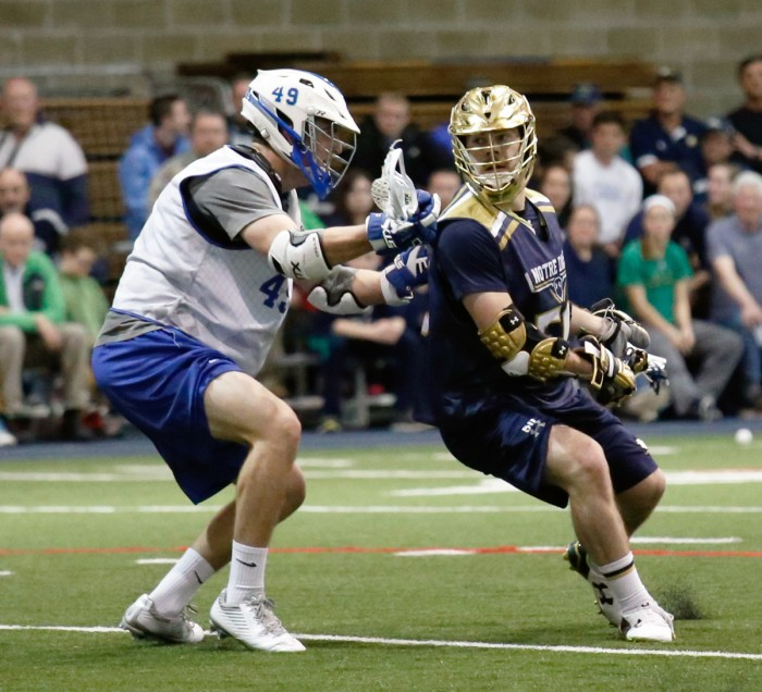Irish senior attack Matt Kavanagh attempts to shake an Air Force defender during an exhibition game Jan. 30. Kavanagh registered a hat trick for the Irish during their win over Georgetown on Saturday.