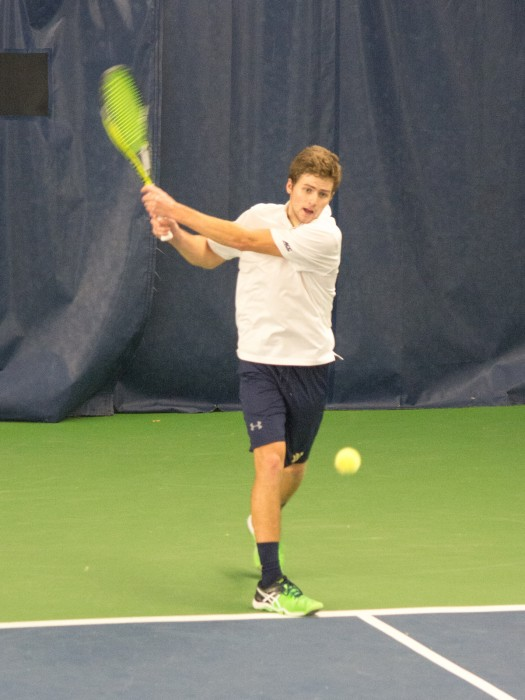 Senior Quentin Monaghan returns a forehand during an Irish 7-0 win over Ball State at Eck Tennis Pavilion on Feb. 7.