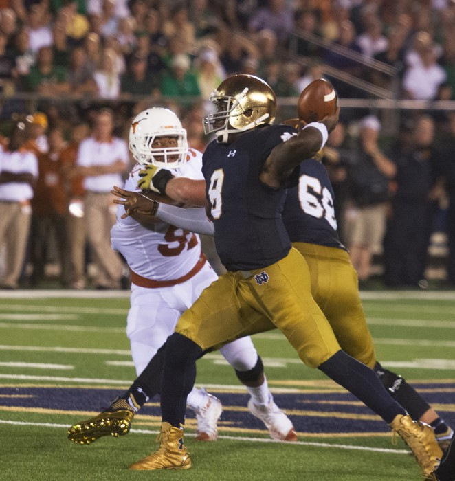 Senior quarterback Malik Zaire winds up for a pass during Notre Dame's 38-3 win over Texas on Sept. 12.