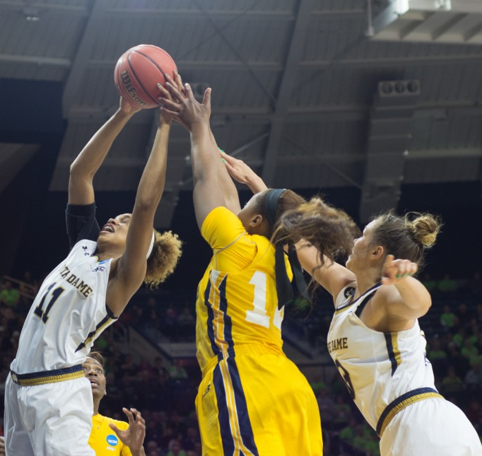Irish sophomore forward Brianna Turner snags a rebound away from a North Carolina A&T player while Irish freshman guard Marina Mabrey looks on during Notre Dame's 95-61 victory Saturday at Purcell Pavilion in the first round of the NCAA tournament.