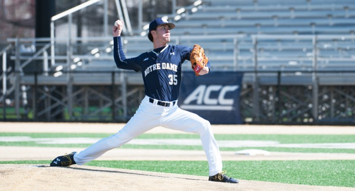 Sophomore pitcher Peter Solomon delivers a pitch during the Irish 10-2 victory over the Demon Deacons on Sunday at Frank Eck Stadium.