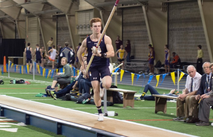 Irish junior pole vaulter Nathan Richartz runs down the strip during the Alex Wilson Invitational at Loftus Sports Center on Feb. 20. Richartz placed first in the event with a personal best of 5.32 meters.