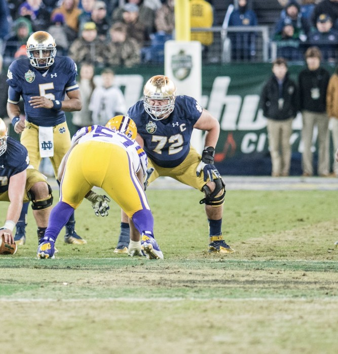Former Irish offensive lineman Nick Martin readies for the snap during Notre Dame's 31-28 win over LSU in the Franklin American Mortgage Music City Bowl on Dec. 30, 2014. Martin was drafted by the Houston Texans with the 50th-overall pick in the NFL Draft on Friday night.