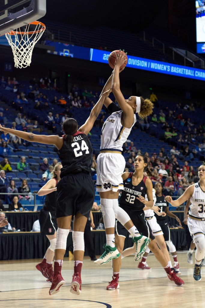Irish sophomore forward Brianna Turner jumps over a defender for a layup during Notre Dame's 90-84 loss to Stanford on March 25.