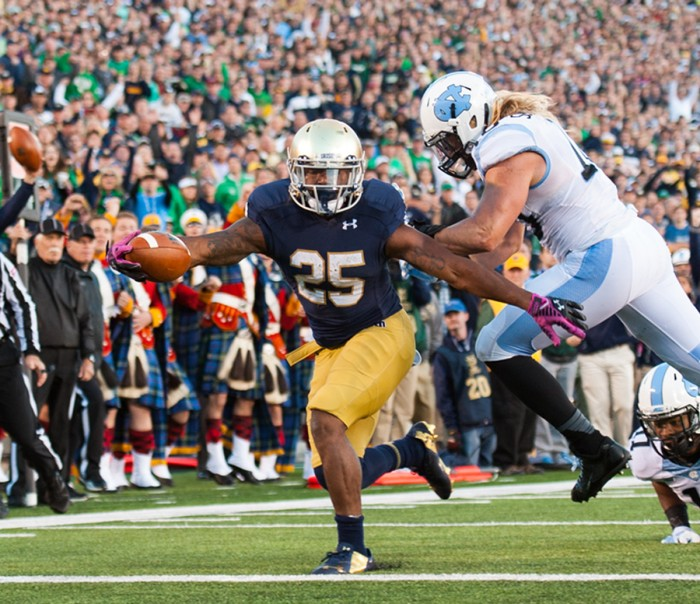 Irish senior running back Tarean Folston extends for a touchdown against North Carolina on Oct. 11, 2014.