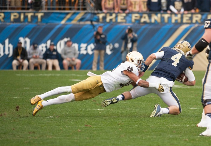Irish senior safety Max Redfield takes down Pittsburgh quarterback Nate Peterman during Notre Dame's 42-30 win over the Panthers at Heinz Field in Pittsburgh. Redfield was one of six Irish players arrested overnight in two separate incidents.