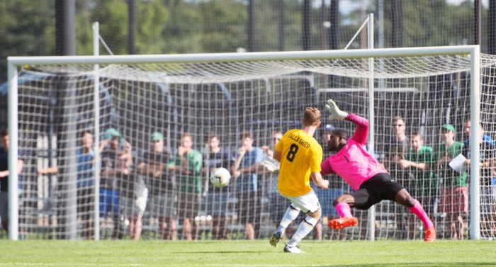 Irish junior forward Jon Gallagher scores against the Valparaiso goalkeeper during Notre Dame's 1-1 draw with the Crusaders at Alumni Stadium on Aug. 22. Gallagher led the Irish with 9 goals scored last season.