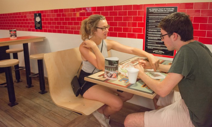 Senior Grace Watkins and 2015 alumnus Alex Caton share a meal at the new Jimmy John's location on Eddy Street. The new location opened between the Hammes Bookstore and Blaze Pizza on June 22.