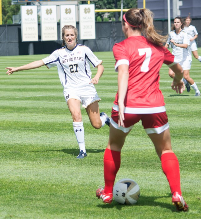 Irish senior forward Kaleigh Olmsted closes out the ball carrier during Notre Dame's 1-0 victory over Wisconsin on Aug. 21 at Alumni Stadium.