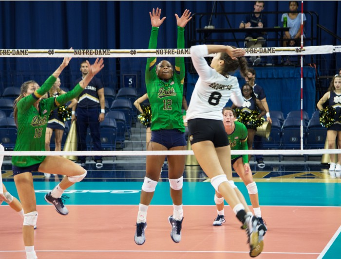 Irish freshman outside hitter Jemma Yeadon jumps for a block during the Golden Dome Invitational on Saturday at Purcell Pavilion.