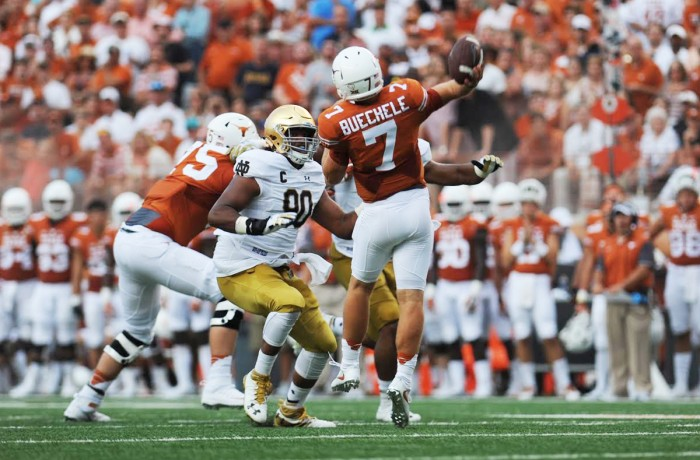 Texas freshman quarterback Shane Buechele gets ready to throw in Texas' 50-47 win. Buechele threw for 280 yards on 16-of-26 passing with two touchdowns in addition to 33  rushing yards. Texas senior quarterback Tyrone Swoopes also contributed 53 rushing yards and three touchdowns as the Longhorns had 517 yards of total offense and 26 first downs.