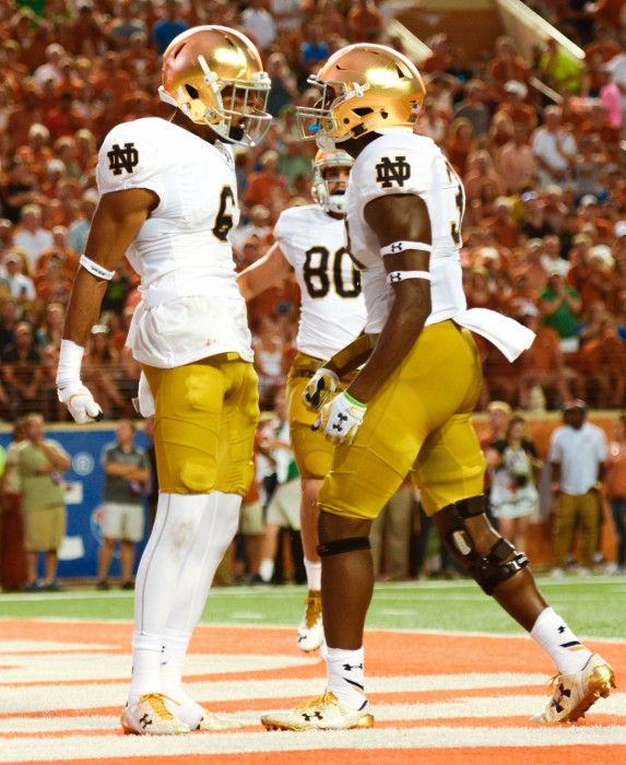 Irish sophomore receiver Equanimeous St. Brown (left) celebrates one of his two touchdowns against Texas Sunday night during Notre Dame's 50-47 loss.