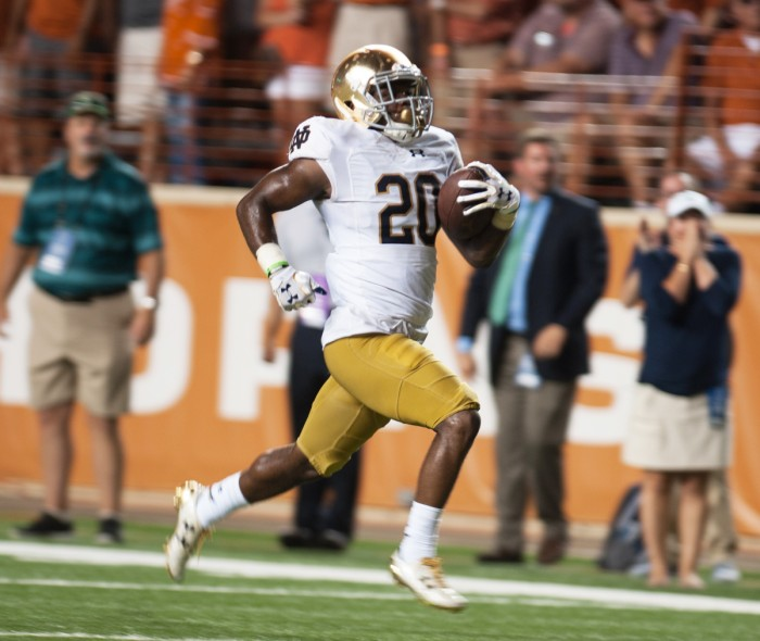 Irish sophomore cornerback Shaun Crawford carries the ball during Notre Dame's 50-47 loss to Texas on Sept. 4. Brian Kelly announced that Crawford will not play for the rest of the season due to an ACL injury.