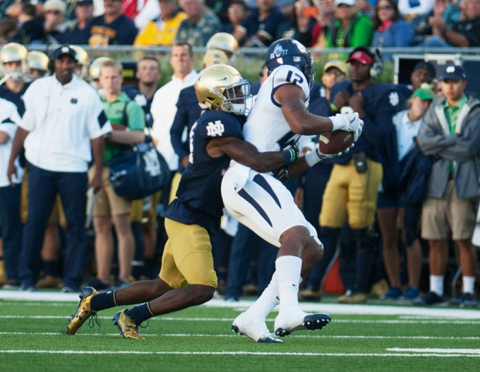 Irish sophomore cornerback Nick Coleman tackles a Wolfpack receiver during Notre Dame's 39-10 win over Nevada on Saturday at Notre Dame Stadium. Coleman is expected to start at cornerback against Michigan State this Saturday.