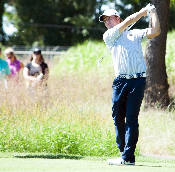 Senior Blake Barens follows through on a swing during the Notre Dame Kickoff Challenge on Sept. 3 at Warren Golf Course.