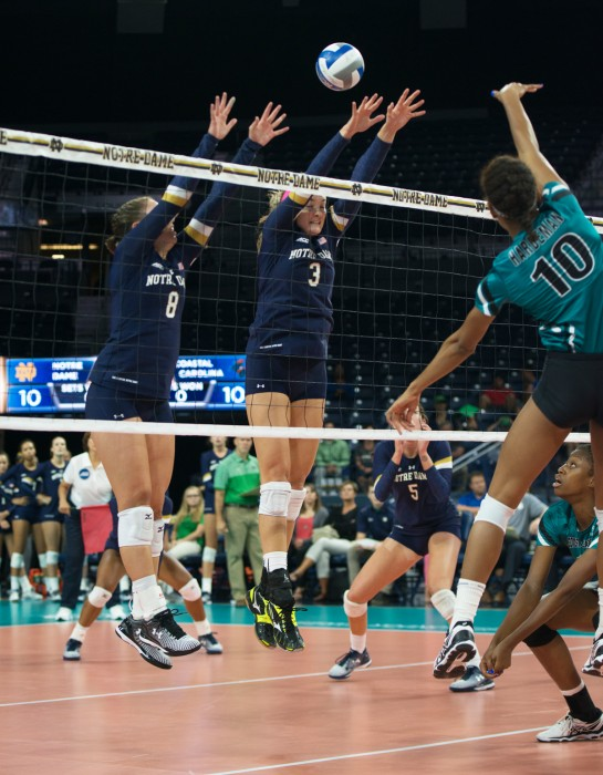 Irish junior setter Caroline Holt, left, and junior middle blocker Sam Fry attempt a block during Notre Dame's 3-0 loss to Coastal Carolina on Sept. 3. Fry leads the team with 29 blocks on the season.