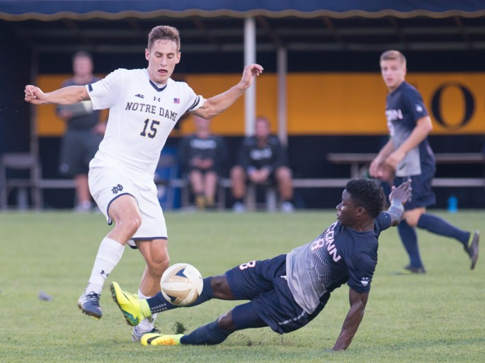Irish graduate student midfielder Evan Panken battles for a loose ball during Notre Dame's 1-0 double-overtime win over Connecticut on Tuesday. Panken has scored two game-winning goals this season for the Irish.